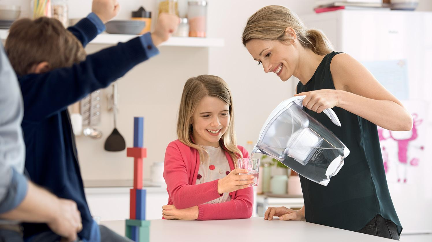 BRITA personal hydration needs family in kitchen
